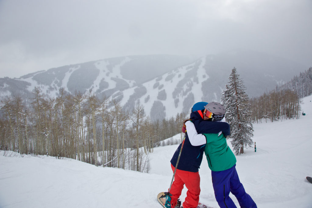 This is how powder days make us feel! Carly Finke and Mariah Schuette. Photo: Jon Resnick