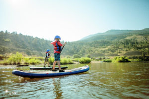 Stand Up Paddleboard at Kids' Day Camp